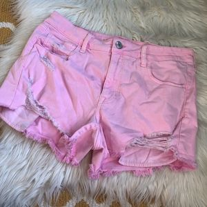 American Eagle pink distressed jean shorts size 14
